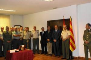Imagen de la despedida del teniente coronel Pérez Francés, con la bandera catalana presente.