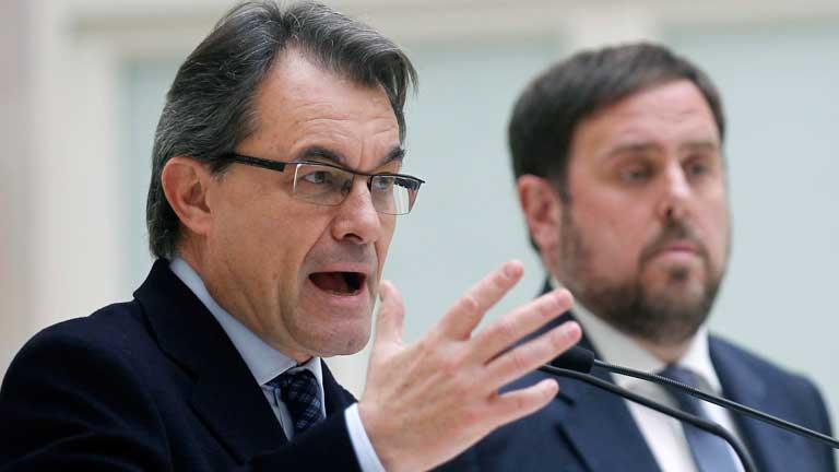 Artur Mas y al fondo el líder de ERC, Oriol Junqueras