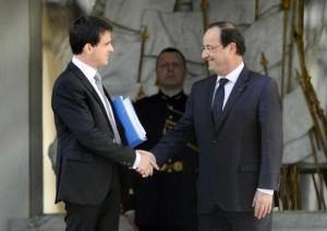 Manuel Valls (i) y François Hollande