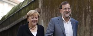 Merkel y Rajoy, ayer, a su llegada a Santiago.