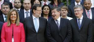 Fátima Báñez y Mariano Rajoy, junto al director general de la OIT, Guy Ryder.