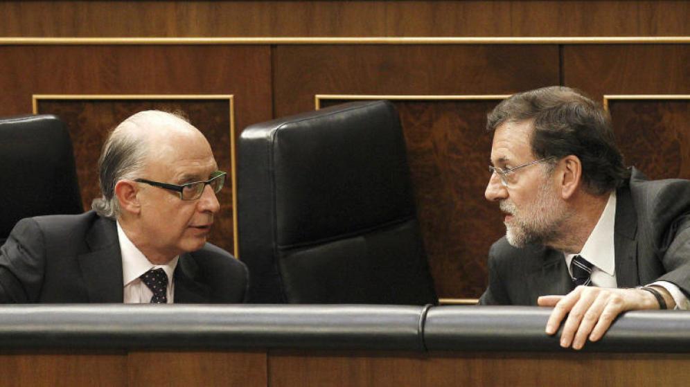 El ministro Cristóbal Montoro junto al presidente de Gobierno, Mariano Rajoy