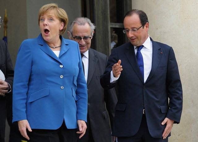 Merkel y Hollande.