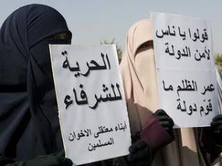 """Sus pancartas dicen: """"Vivo en el Infierno, venid conmigo"""""""