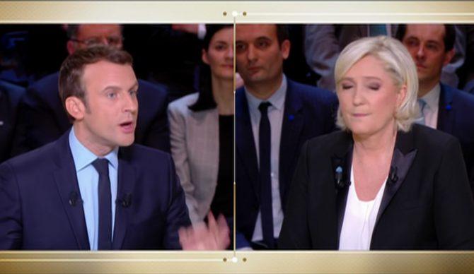 En la campaña de las presidenciales francesas, Marine Le Pen (derecha) es la candidata del cambio anti-establishment y Emmanuel Macron (izquierda), el candidato pro-establishment y del statu quo. (Imagen tomada de un vídeo de LCI).