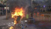 Un carro de súper ardiendo, durante una marcha de la CUP