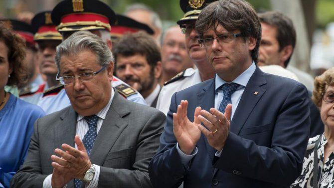 Zoido y Puigdemont.