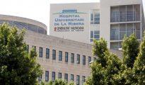 Hospital La Ribera, donde ha sido trasladado el hombre acusado de matar a su hija de dos años en Alzira