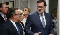 Zoido y Rajoy, en primer término.