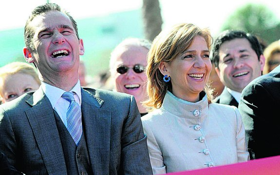Iñaki Urdangarin y Cristina ríen en un acto en Florida en 2010.