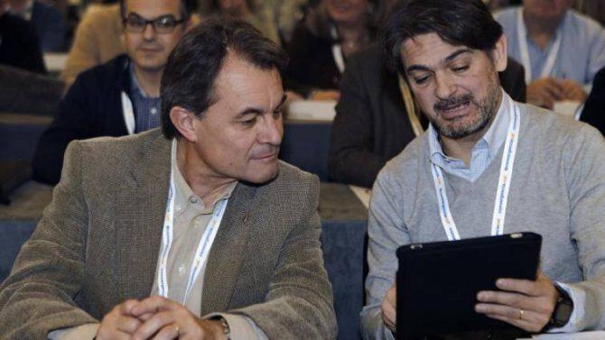 Oriol Pujol, junto a Artur Mas